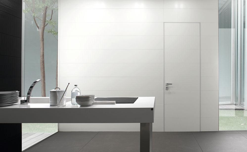 porta-Oikos-modello-SynuaWallSystem-bianco_1 [©OIKOS] aria-label=